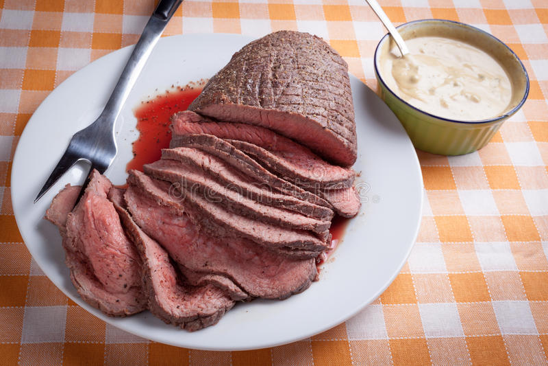 Roast beef. On orange tartan tablecloth royalty free stock images