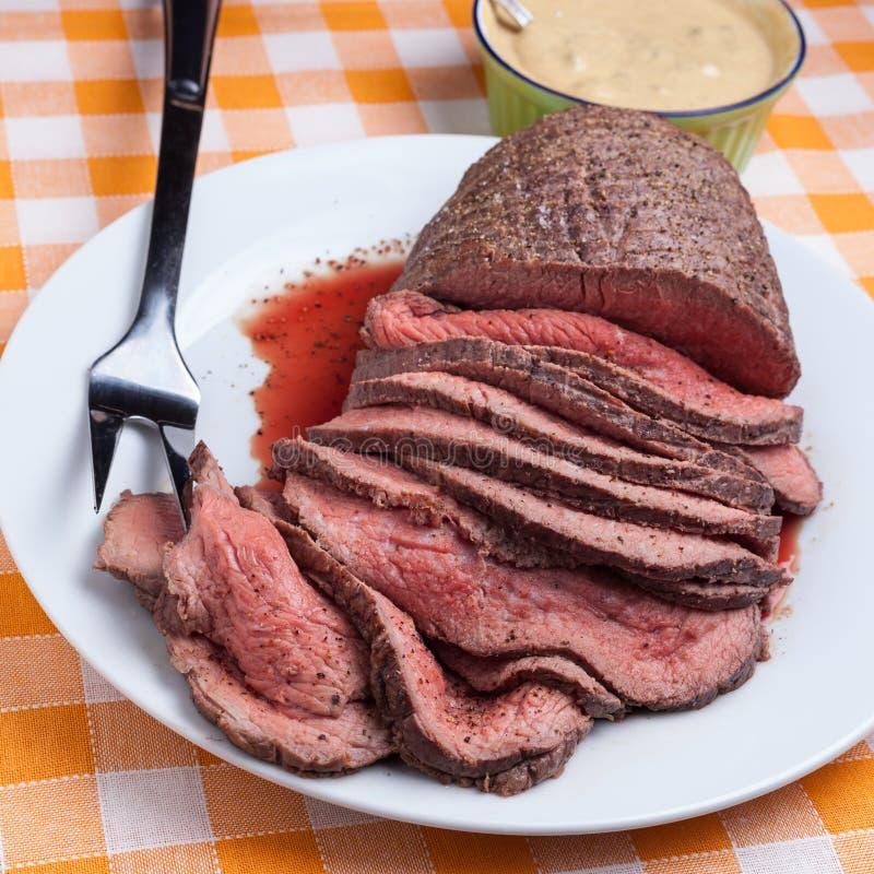 Roast beef. On orange tartan tablecloth stock photo