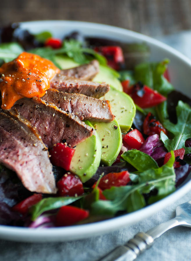 Roast Beef Salad. Mixed green salad with roast beef and smoked paprika aioli stock photos
