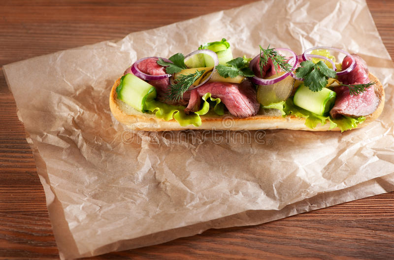 Roast beef sandwich on brown paper stock images