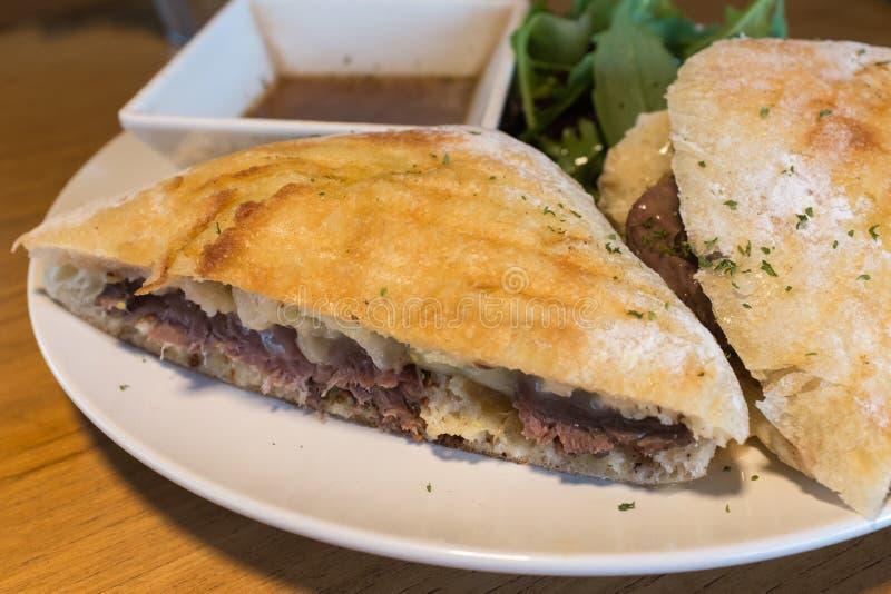 Roast beef sandwich dish with rocket salad stock photography