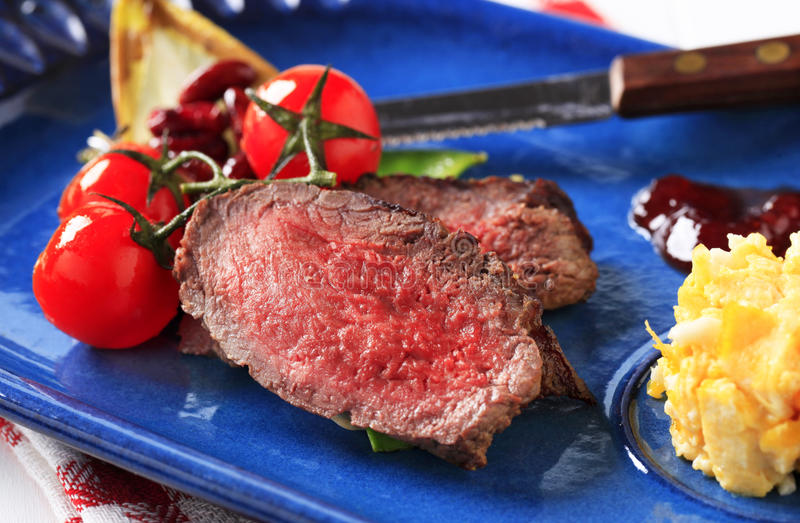 Roast beef with scrambled eggs royalty free stock image
