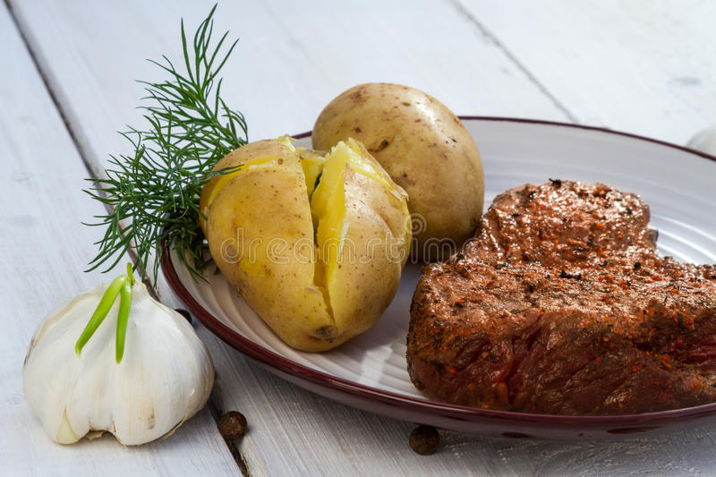 Roast beef steak served with potatoes stock photo