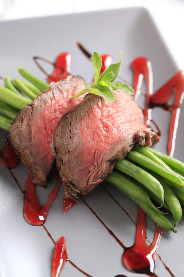 Roast beef with string beans stock image