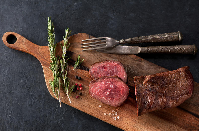 Roast beef on a wooden board. Roast beef on a wooden cutting board stock image