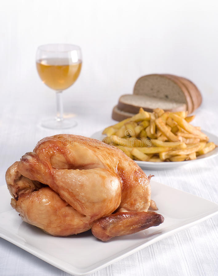 Roast chicken. With french fries and bread stock image