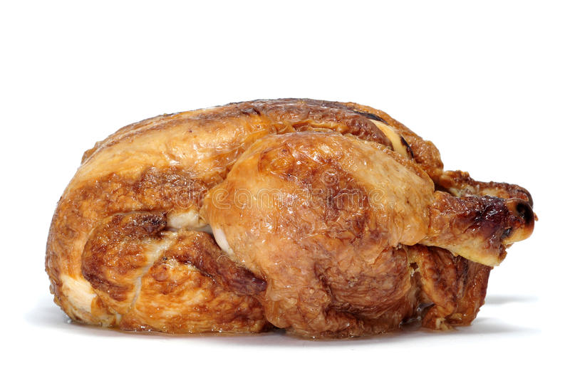 Roast chicken. A roast chicken on a white background royalty free stock photo