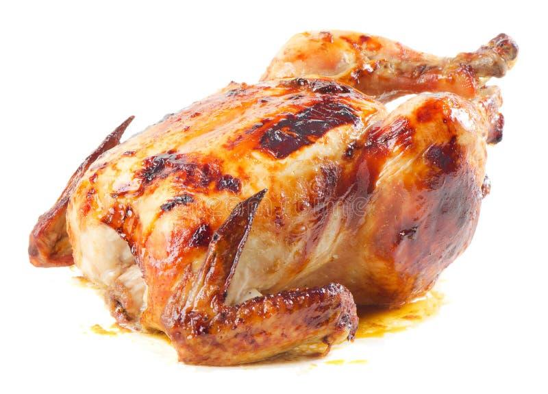 Roast chicken. On white background stock photos