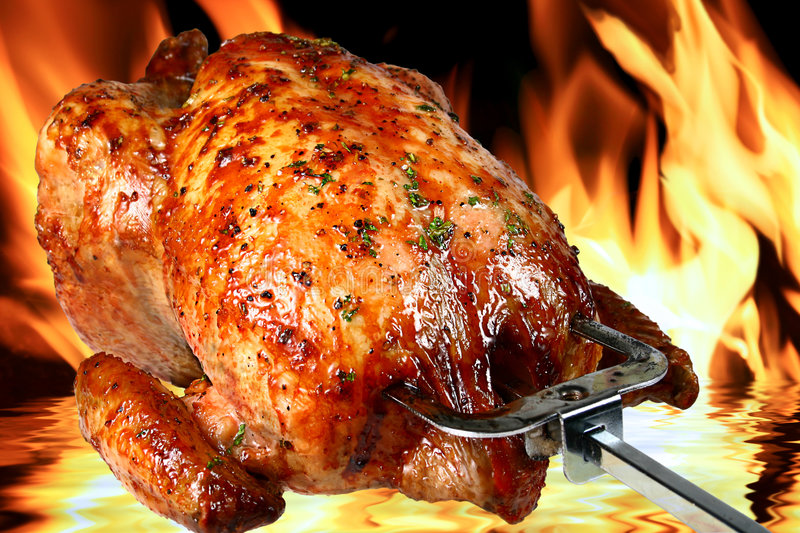 Roast chicken. Image of delicious roasted chicken on flame background