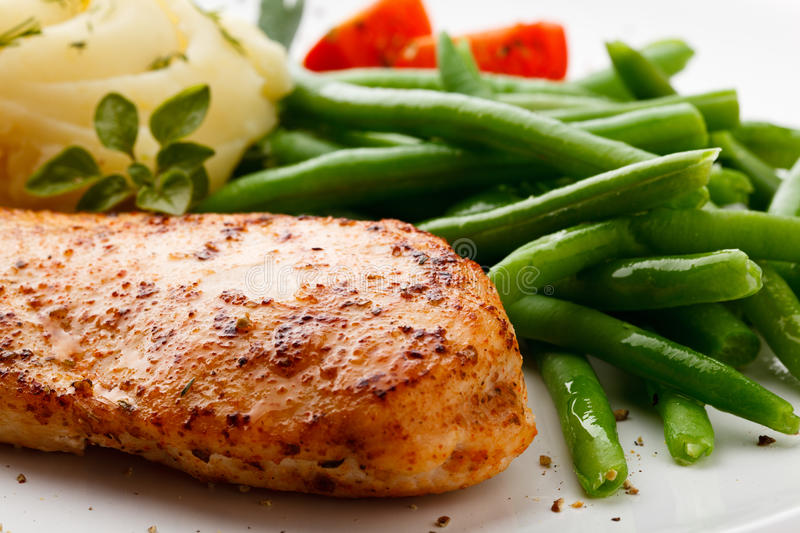 Roast chicken breast. And green beans stock photos