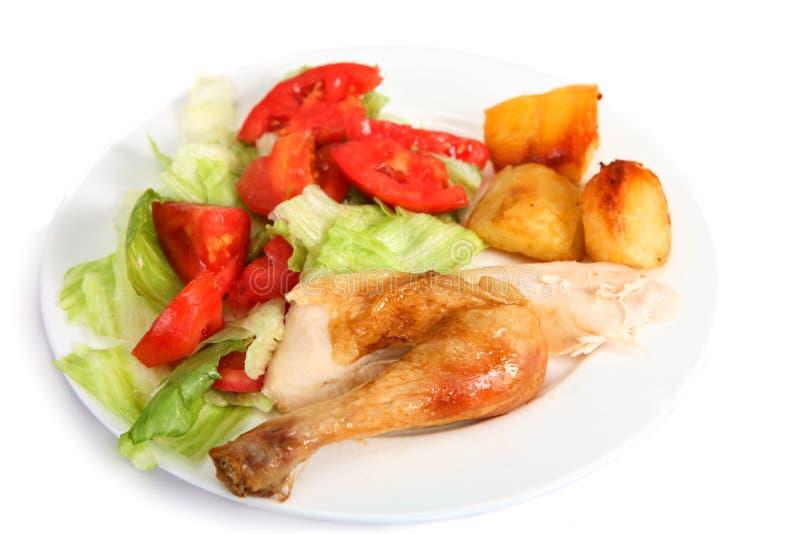 Roast chicken dinner with salad stock photos