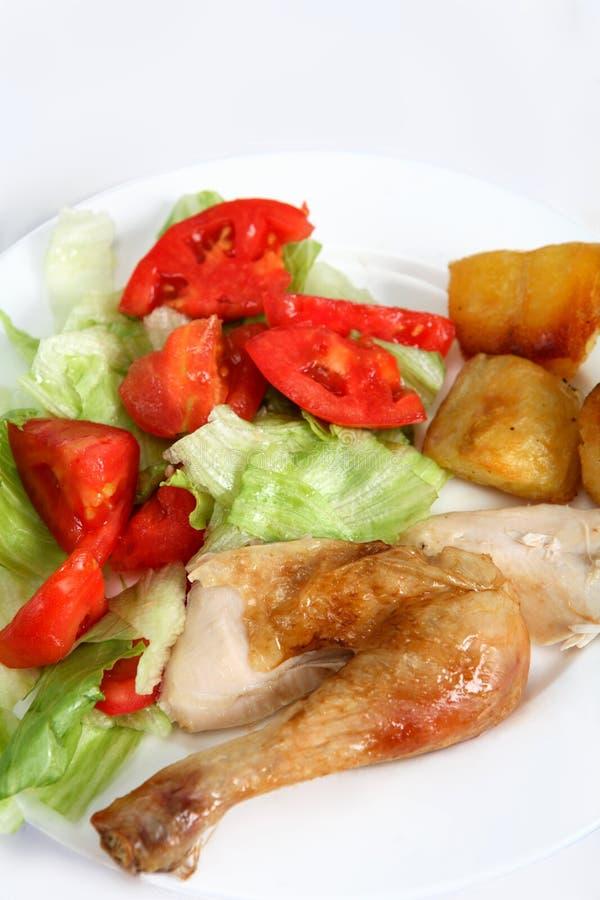 Roast chicken dinner with salad stock photo