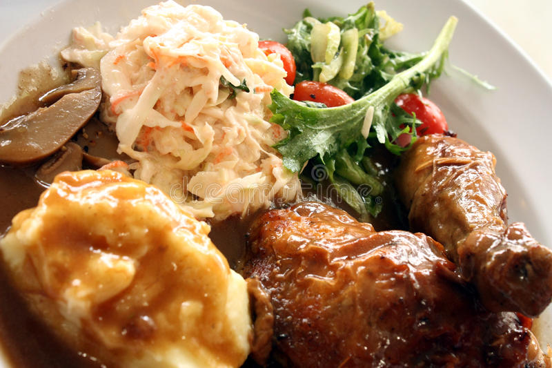 Roast Chicken with Gravy and Salad royalty free stock image