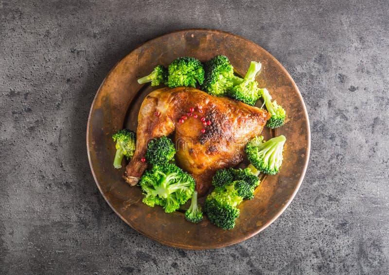 Roast chicken Leg. Chicken roasted leg with broccoli on concrete stock image