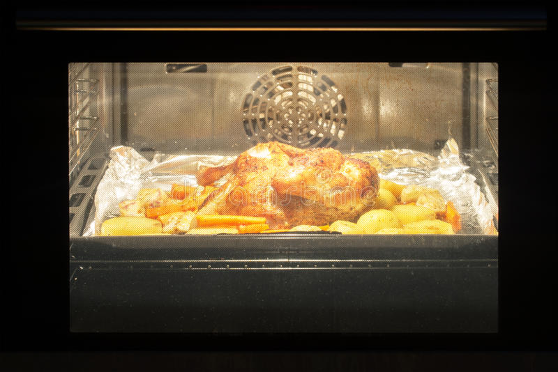 Roast chicken in the oven royalty free stock photography