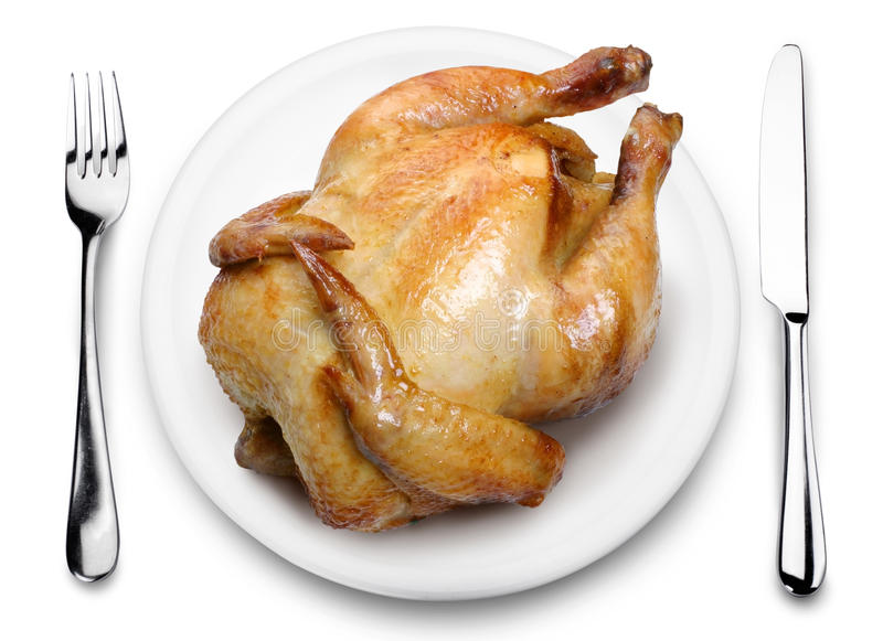 Roast chicken on a plate. View from above on a white background royalty free stock photography