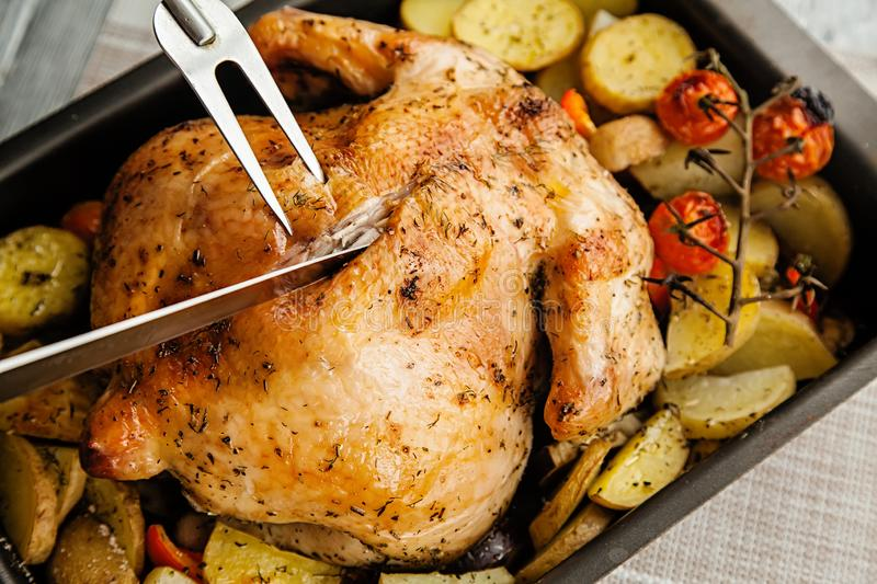 Roast chicken and potato slices for thanksgiving day holiday stock photos