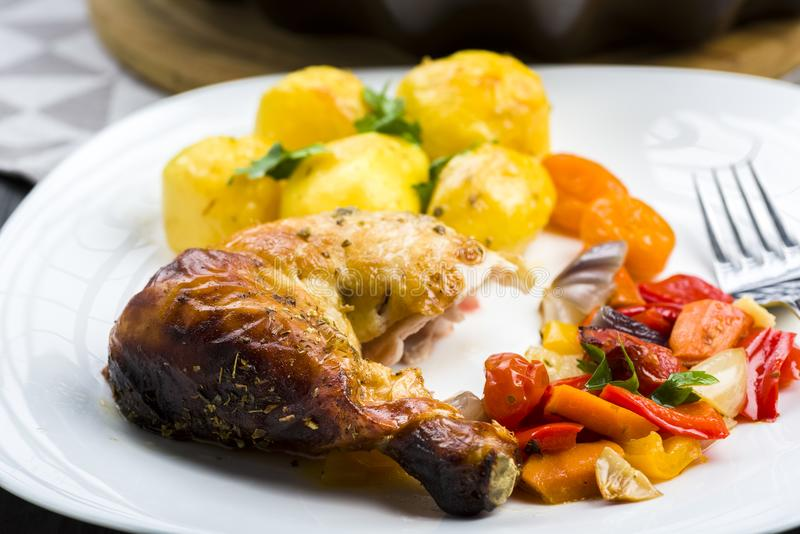 Roast chicken with potatoes royalty free stock photography