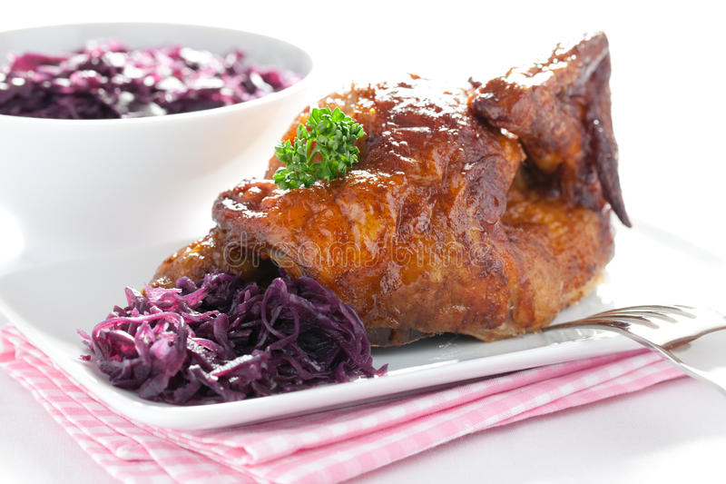 Roast chicken and red cabbage stock image