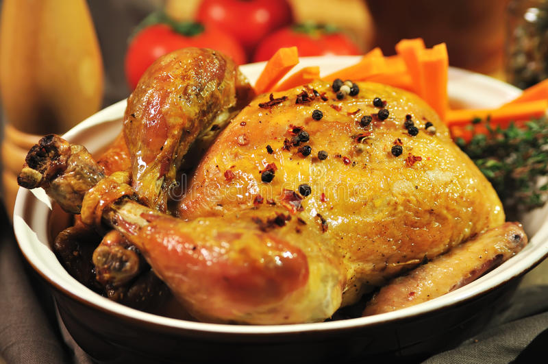Roast chicken. With spices in a bowl stock images