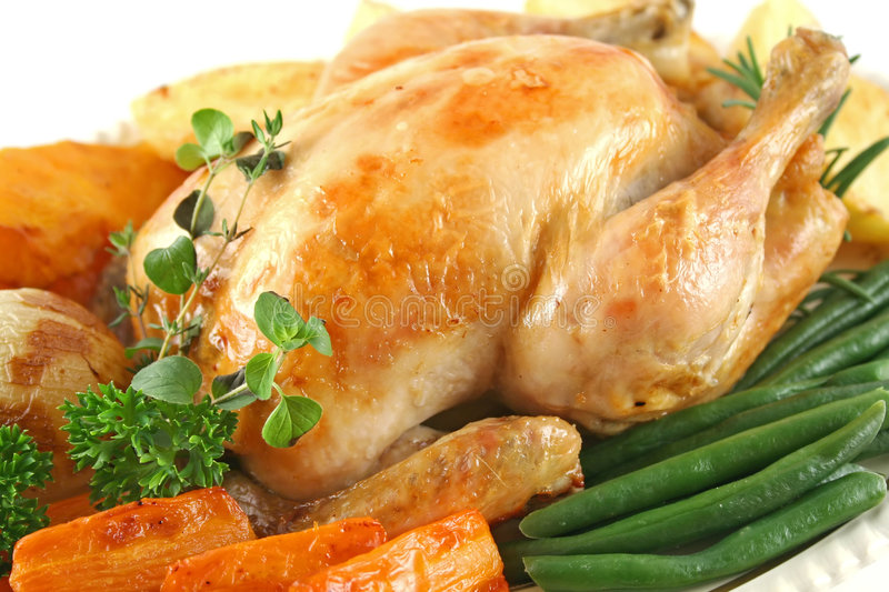Roast Chicken And Vegetables stock images