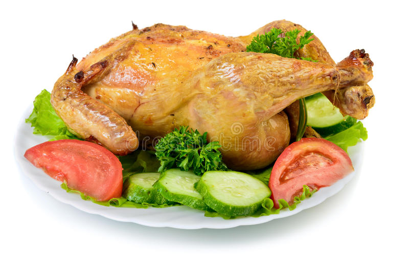 Roast Chicken. With vegetables on dish stock image