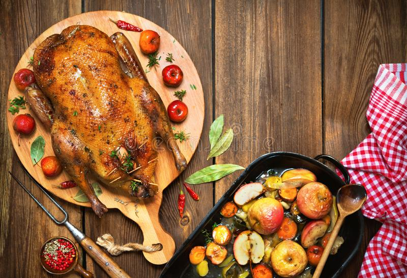 Roast Christmas duck with apples stock photography