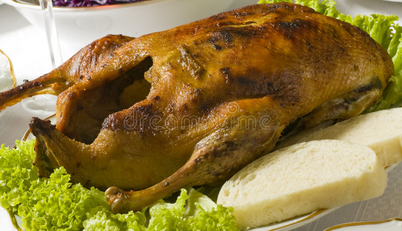 Roast duck. With Dumplings on the table stock photos