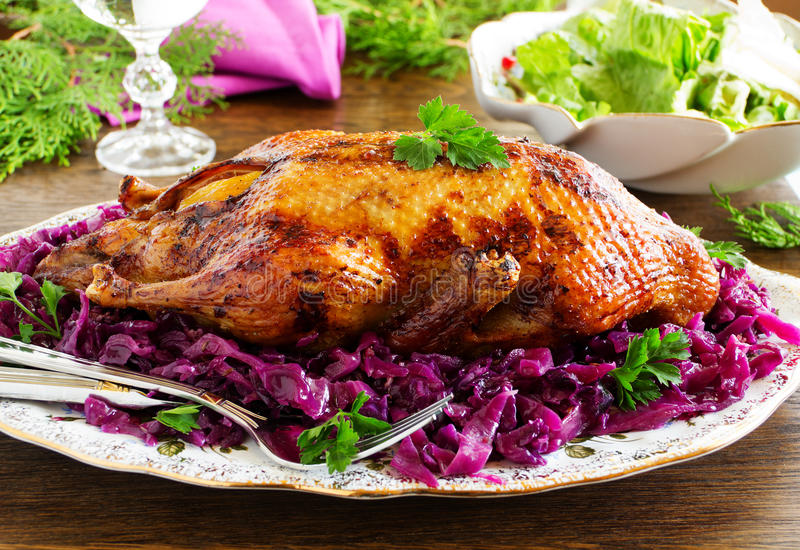 Roast duck with apples. And red cabbage stock photo