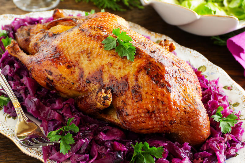 Roast duck with apples. And red cabbage royalty free stock image