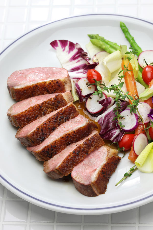 Roast duck breast with vegetables stock photography