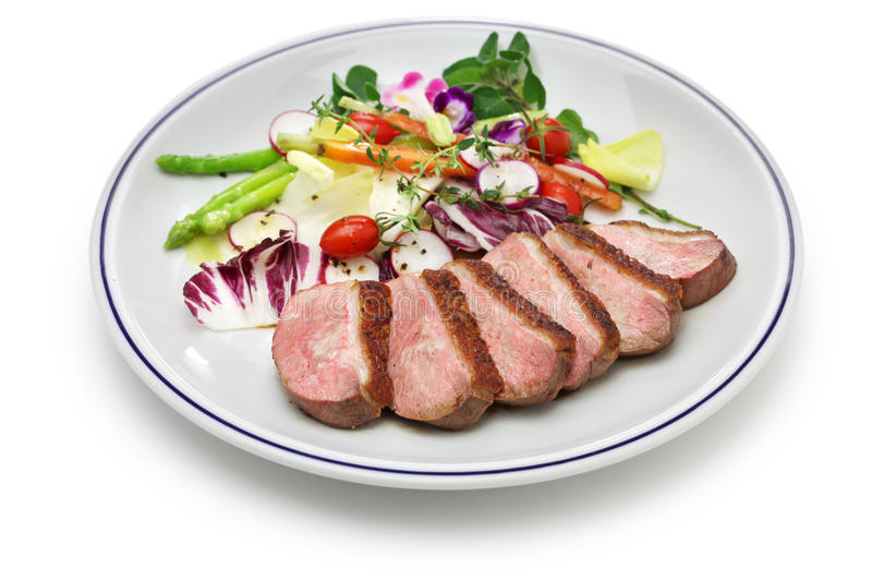 Roast duck breast with vegetables royalty free stock photos