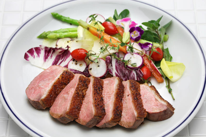 Roast duck breast with vegetables stock photo
