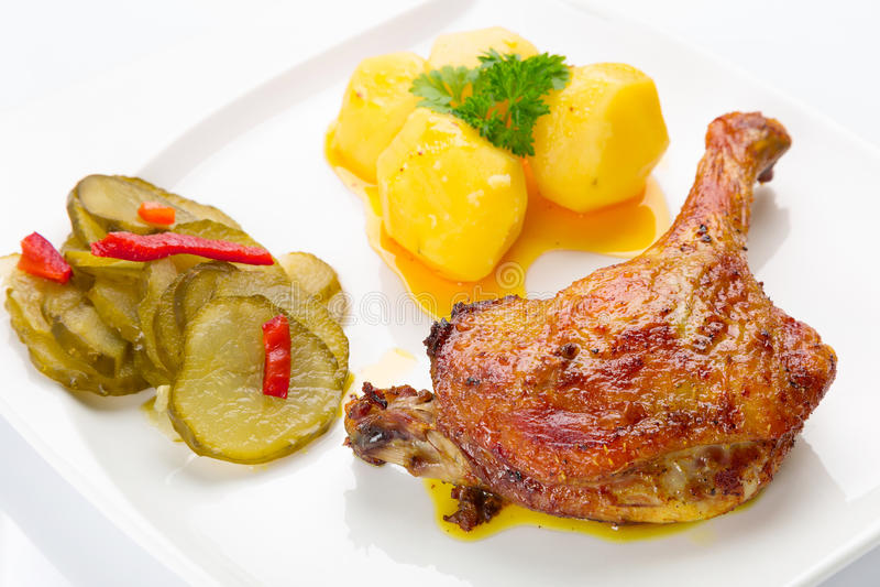 Roast duck leg with potatoes stock image