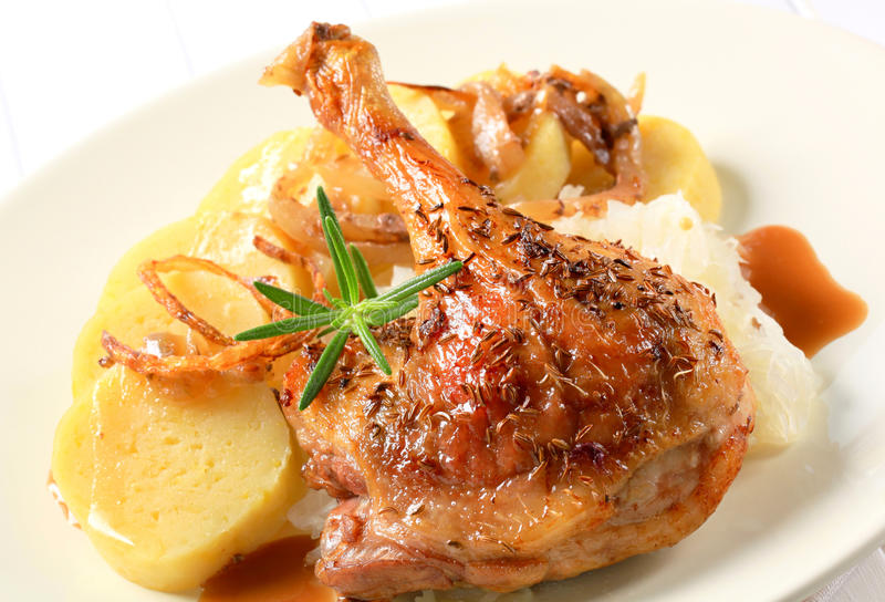 Roast duck with potato dumplings and white cabbage. Roast duck leg with potato dumplings and white cabbage stock image