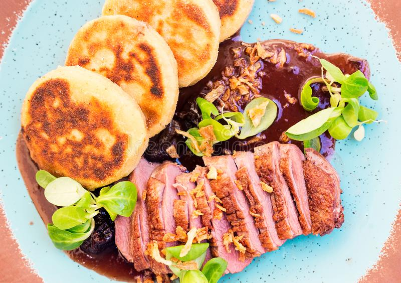 Roast duck with potato pancakes and plum sauce royalty free stock photography