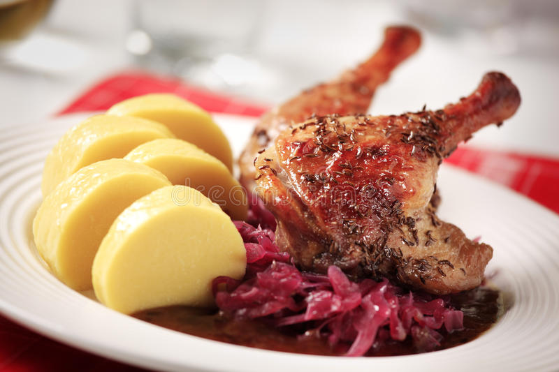 Roast duck, red cabbage and potato dumplings. Czech cuisine - Roast duck, red cabbage and potato dumplings stock photography