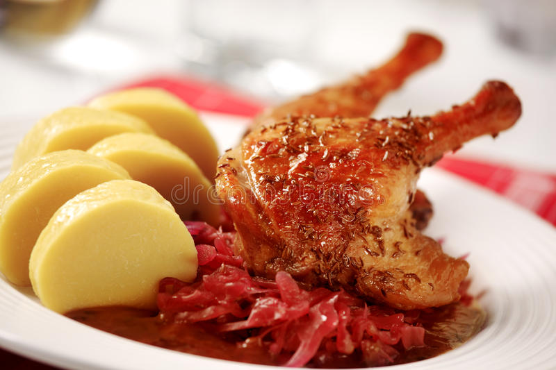 Roast Duck with Red Cabbage and Potato Dumplings. Czech cuisine stock photography