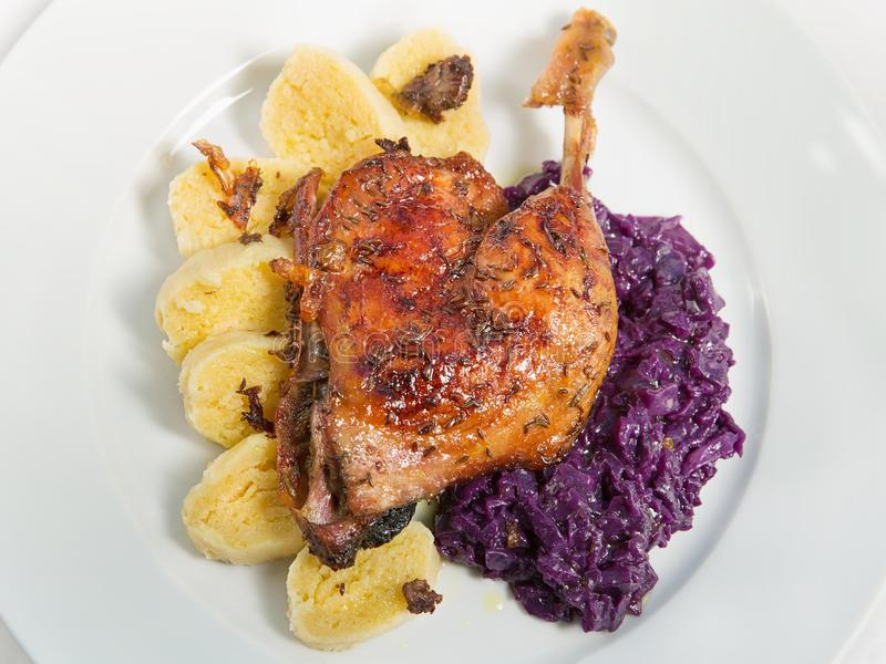 Roast duck. Red cabbage and potato dumplings stock photo