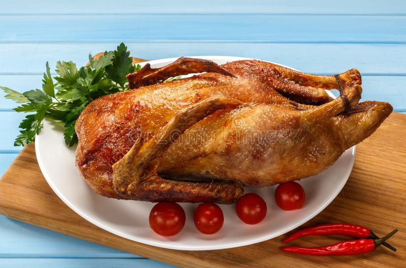 Roast duck on a white platter. Ready to serve poultry. Table set stock images