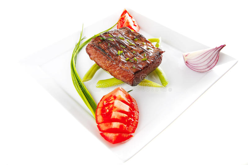 Roast fillet served with tomato royalty free stock photography