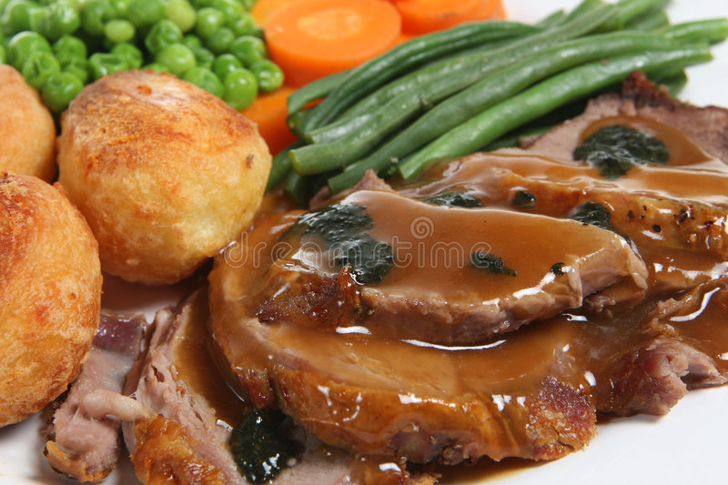 Roast Lamb Dinner. With mint sauce and gravy royalty free stock photo
