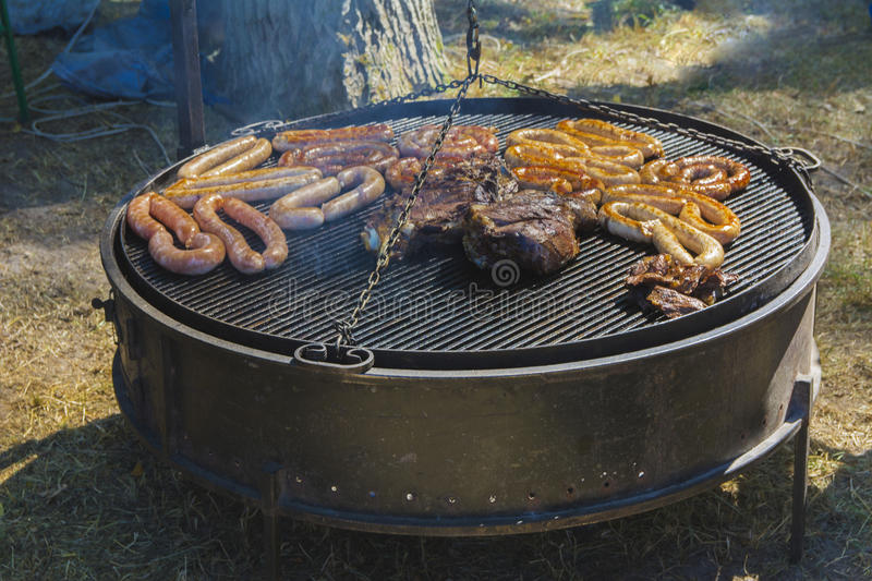 Roast large chunks of meat and sausage royalty free stock photos
