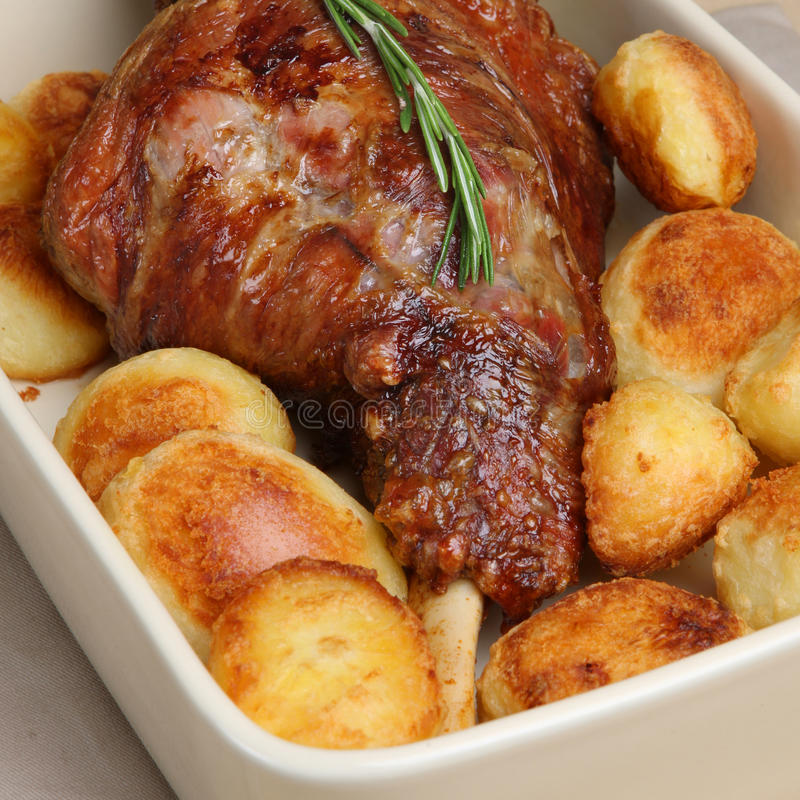 Roast Leg of Lamb. Roasted leg of lamb with roast potatoes royalty free stock image