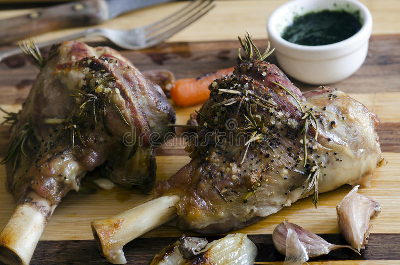 Roast leg of lamb. With rosemary and garlic stock photography