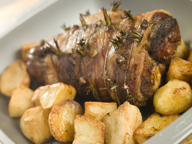 Roast Leg of Lamb Studded with Rosemary and Garlic royalty free stock photos