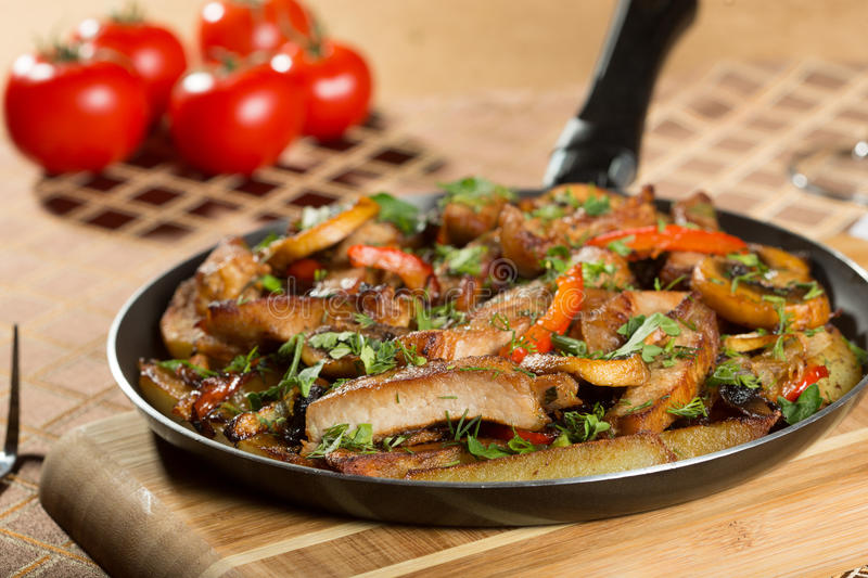 Roast meat in a frying pan. stock photography