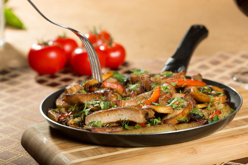 Roast meat in a frying pan. royalty free stock photo
