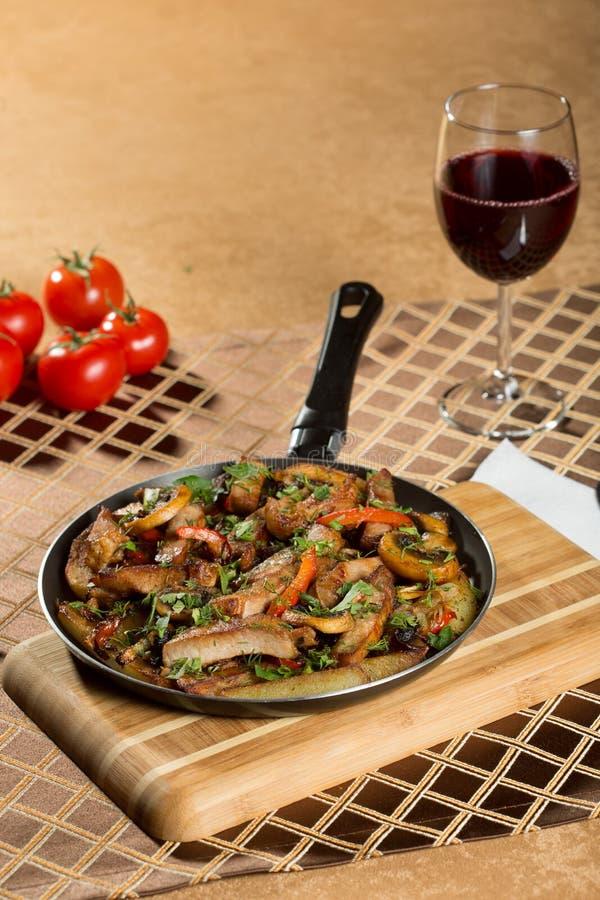 Roast meat in a frying pan. stock image