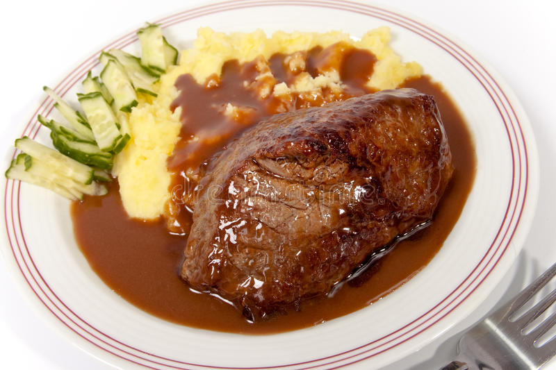 Roast meat with potatoes and sauce royalty free stock photos